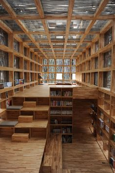 cool library... all it needs is a GIANT sofa (with an abundance of pillows) in the center of the room.