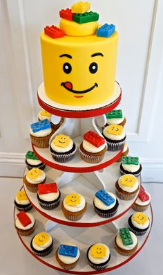cute lego cake with cupcakes...(except for the legos on his head)