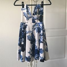 Blue Floral V-cut Dress Perfect for a sorority formal or drinks with the girls, this plunging neckline is adorable with wedges or pumps! Lulu's Dresses Mini