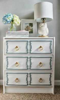 Ikea RAST 3-drawer dresser ($34.99) with some pretty overlays (just think of all the possibilities of shapes & colors). White on white with some distressing for a cottage look.
