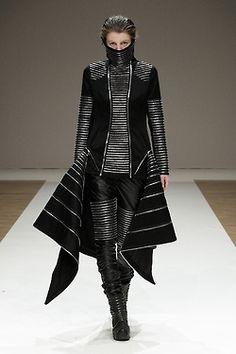 Futuristic Clothing, future girl, fashion show, futuristic style, futuristic look, girl in black, futuristic girl, future fashion, model by FuturisticNews.com