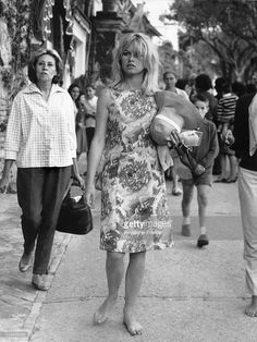 Brigitte BARDOT is walking barefoot in the streets of Capri, Italy where the outside scenes were shot. She was at that time playing in Jean-Luc GODARD's film, LE MEPRIS ('Contempt'). Bridgitte Bardot, Slim Aarons, Audrey Hepburn, Brigitte B, Star Francaise, Lee Radziwill, Non Plus Ultra, Fritz Lang, And God Created Woman