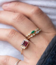 This beautiful ring showcases a vibrant garnet stone in a stunning setting for a truly stand-out look. Bezel set 6mm square garnet. Flanked by six 1.3mm white diamondsMilgrain detailPoint of stone ex