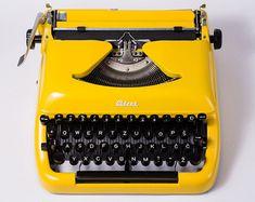 Yellow Typewriter UNIS tbm Olympia by TuTuVintageBeautiful on Etsy