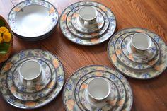 """THIS IS AN INCREDIBLE DEAL. Mikasa Intaglio Garden Harvest for family dinners! Designs inspired from country orchards, this stoneware offers subtle shades of peach, green, blues, and plums. Each of these 5pc place settings include an 11"""" dinner plate, 8.5"""" dessert/salad, cup, and a 9.5"""" soup bowl. I often have used the saucer for a salad plate or dessert, as well. No chips or cracks, but please note that the dinner plates, and salads do show a sign of wear in some centers, as would be"""