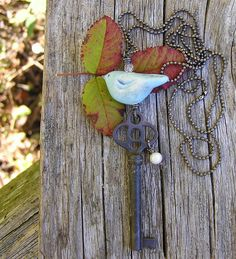 bird necklace with vintage skeleton key and freshwater pearl. ceramic blue bird pendant necklace. long ball chain necklace. OOAK.