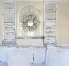 Old shutters in cottage living room with a shabby chic look