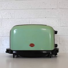 The perfect vintage toaster.  I still have and love my Toastmaster Red tombstone top toaster.  Took that as part of the divorce settlement!