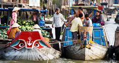 Discover Cai Be floating market and Tan Phong Island - Full Day. To this tour, you feel peace and simple life of local people living in countryside of Mekong delta.