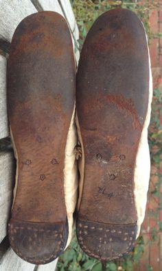 Pinner says: c1810 beige canvas boots. Sole detail. Straight soles with nailed heels. So designed for practicality. Length 8 1/2in, width 2 1/2 in. Typically tiny Regency size.