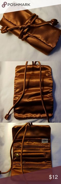 NaRaYa   Jewelry Pouch Great little jewelry pouch great for travel. Copper color.  Its new no tags. NaRaYa Accessories