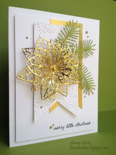 "Happy Fall everyone! Can't wait for sweater weather to hit southern California! Here is a super simple Christmas card made with the Small Luxe Poinsettia and the Pine Sprigs dies. I cut a piece of white card stock measuring 5"" x 3.75"". Before adhering it with mounting tape to the white card base, I stamped ""merry little Christmas"" on the bottom right. This is part of the ""Have yourself a merry little Christmas"" stamp. I only wanted to use the ""merry little Christmas"" words for this card, so…"