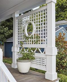 This is an imaginative and charming custom lattice porch privacy screen in East Greenwhich, RI is crafted in low maintenance AZEK Porch Trellis, Porch Lattice, Lattice Screen, Porch Privacy Screen, Outdoor Privacy, Privacy Walls, Privacy Screens, Porch Railing Designs, Porch Railings