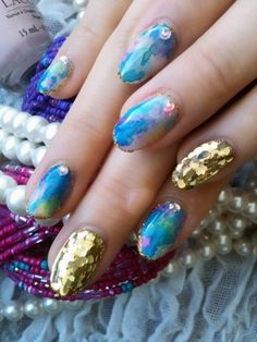 http://static.becomegorgeous.com/img/arts/2012/May/13/7763/earth_tone_mix_nail_art.jpg