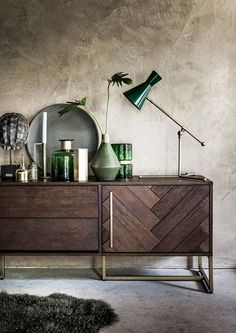 Summer style!! Modern contemporary credenza with green accessories and very modern green lamp! Storage with style!