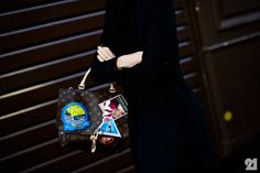 Colette buyer with her Louis Vuitton bag