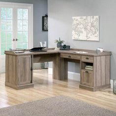 "With its ""L"" shaped design and rustic oak finish, this eye-catching desk rounds out any space in sophisticated style. Top it with an antiqued table lamp to illuminate your work or pair it faux-leather office chair for a complementing look. Furniture Sale, Furniture Ideas, Home Office Design, Office Decor, Office Ideas, Desk Ideas, Ikea Office, Office Inspo, House"