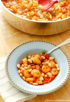 Spicy Garlic Shrimp and White Beans with Tomatoes from www.a-kitchen-addiction.com