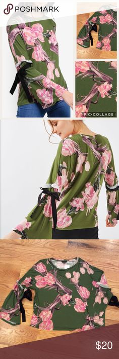 Topshop Floral Tie Flute Sleeve Blouse NWOT Topshop Floral Tie Flute Sleeve Blouse. Viscose jersey in an oversized floral print. Long sleeves with grosgrain ribbon ties. New without tags- never worn. Comment with any questions or make an offer. Topshop Tops Blouses