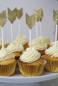 Gold cupcakes at a boho feather birthday party! See more party ideas at CatchMyParty.com!