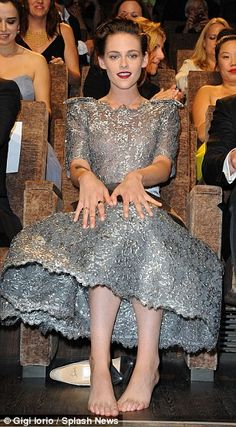 Tickled: Kristen showed her silly side while relaxing barefoot in her VIP seat...