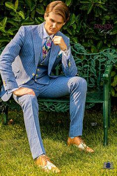 Italian bespoke light blue striped pure linen suit with wide peak lapels, 2 corozo buttons, ticket pocket and double vent. 100% linen fabric. Wedding suit 1817 Fashion Color Collection Ottavio Nuccio Gala.