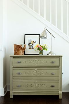 Olive Green Dresser Makeover by Michele Omega: featured at Mrs. Hines' Class  very unusual color.  love the way details on dresser show up and I like what she has displayed on top