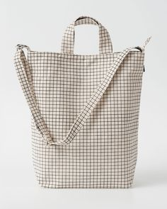 A perfect everyday tote in durable recycled cotton canvas duck. Two handles and 40 in. adjustable strap, to carry in hand or over shoulder. **** 16 in. H x 10 in. W x 5.5 in. D. Matte silver hardware.
