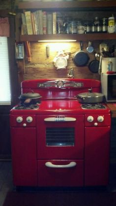My husband painted our white stove red. A 1950's Tappan. Happy Birthday to me! #CoolRetroHomeDecorBigChill