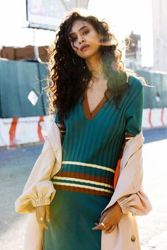 Ziayla Pizarro by Della Bass. Look - Stylist's own Hoop Earrings, Assorted Rings (all) Nissa Jewelry, Tibi Drape Twill Trench Coat and Use Unused Striped Dress
