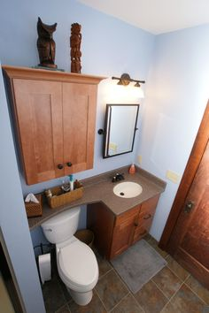 Craftsman - counter over toilet - wish it had a drawer . lots of similar at HOUZZ.com