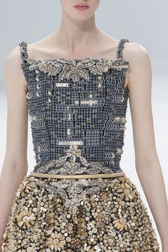Chanel Haute Couture Fall 2014  To see how these pieces are made--those little squares are concrete, hand-stitched and beaded--go to the chanel.com website and view the short film on the making of this collection.  Astounding.