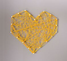 A heart made from rubber bands and push pins*•*•*•*