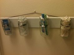 One of the best things I've made! amazing for our tiny tiny bathroom! #diy #masonjars #bathroom