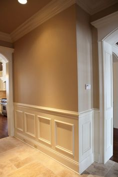 Two tone dining room with chair rail light color above Crown molding india