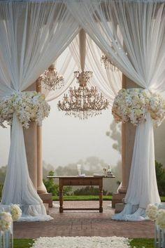 Chandelier-and-Chiffon Wedding Ceremony Backdrops | Brides.com