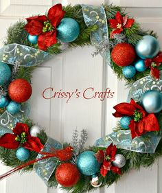 Crissy's Crafts: Christmas wreath - love the aqua and red combo (she has a gorgeous red/aqua tree too, but put all our ornaments we received throughout the years as well as our kids' ornaments so we'd never have room for matching ones too lol!)