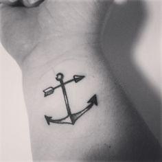 Anchor and arrow tatoo
