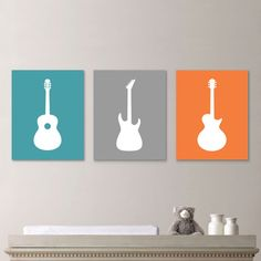 Baby Boy Guitar Nursery Art Prints:    This is a three-print set featuring a solid background with the silhouette of three different types of