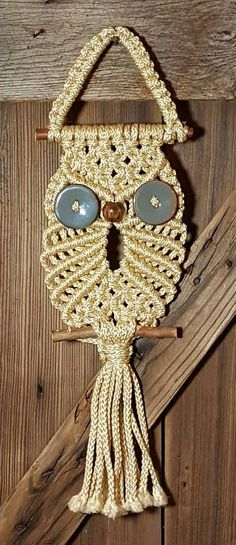Handcrafted Macrame Owl Man-made Fibers with Wood and Stoneware Embellishments Red Cedar Wooden Perch and Hanger Each Owl is carefully handcrafted in our workshop by Greg Goodwin.