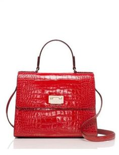 Kate Spade New York Knightsbridge Doris Croc Embossed Satchel.  I just bought it in black.  It reminds me of an Hermes Kelly, which I shall buy when I win the lottery.