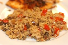 Dirty Rice Ingredients:1 link Italian sausage, casing removed1 tablespoon olive oil½ cup diced onion¼ cup diced red bell pepper2 cloves garlic, minced¾ cup long grain white rice1½ cups low-sodium chicken or veggie brothSalt and cayenne pepper, to taste½ cup chopped scallions Preperation:1. Crumble the sausage into a skillet or large saucepan over medium-high heat. Cook until starting to brown, 2-3 minutes.2. Stir in the olive oil, onion, bell pepper and garlic. Cook until just softened, 2-3 minutes more.3. Stir in the rice and cook for 1 minute. Mix in the broth. Bring the mixture to a boil, reduce the heat to a simmer, cover and cook until the rice is tender, about 20 minutes.4. Season to taste with salt and cayenne pepper. Stir in the scallions. Fluff with a fork and serve.