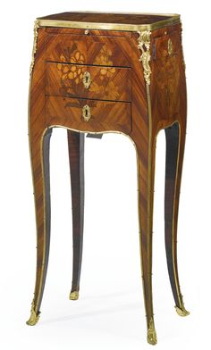 A Louis XV ormolu-mounted tulipwood and marquetry table en chiffonnière circa 1755