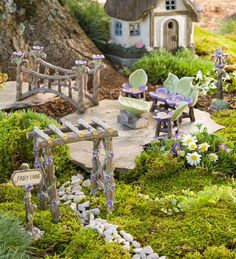 Miniature Fairy Garden Fairy Lane Set is a delightful addition to your miniature or fairy garden. Set includes Fairy Lane sign, arbor, foot bridge, seating set and lamppost, all beautifully accented with pretty purple flowers. Mini Fairy Garden, Fairy Garden Houses, Gnome Garden, Fairies Garden, Fairy Gardening, Gardening Quotes, Garden Fun, Fruit Garden, Fairy Garden Furniture