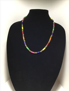 Handmade fabric bead necklace accented with brass and glass beads.