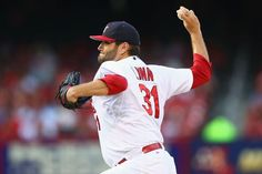 Starter Lance Lynn pitches against the Miami Marlins in the first inning. Cards won the game 3-2. 7-04-14