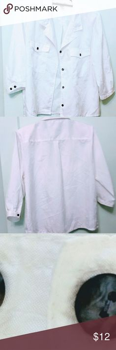 """Joan Harper White 3/4 Sleeve Button Up Blouse This white blouse has 3/4 sleeves & grey/black mottled buttons The sleeves have a 2 button closure. There are original shoulder pads, easily removable. It has. 2 chest pockets with buttons. There are 2 pleats in back for comfort. Made of 100% polyester. Measurements : shoulder to shoulder = 16.5"""", armpit to armpit = 22"""" sleeves 11.25"""", length = 23.25"""" Care machine wash warm,tumble dry low, warm iron if needed. Good condition with no stains, tears…"""