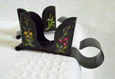 black metal stocking holders shelf sitters with folk art toil painting