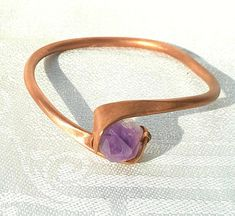 Check out this item in my Etsy shop https://www.etsy.com/listing/551424836/copper-and-raw-amethyst-bangle