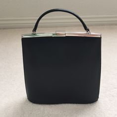 NWT Beautiful Dressy Classic Black Purse NWT Beautiful Black Classic Faux Leather Handbag and silver plated clasp. Measurements: 9X9X2. No trade, no holding, no off sight payment Bags Mini Bags